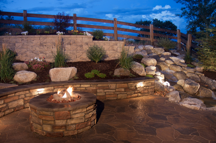 Large backyard patio with brick fire pit