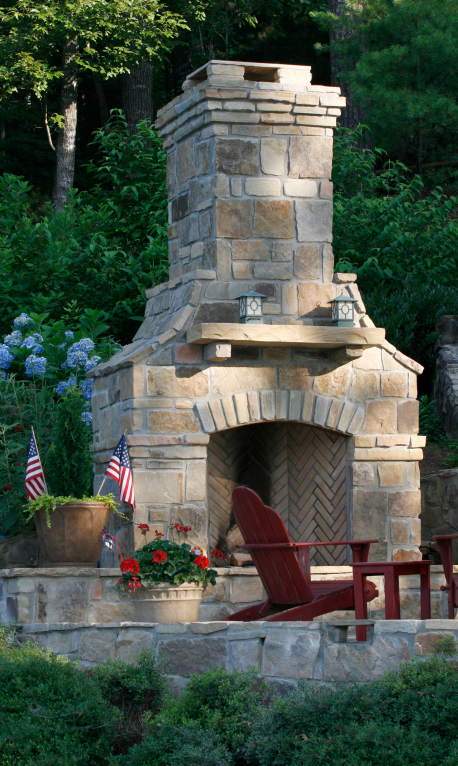 Large brick fireplace on the side of a patio