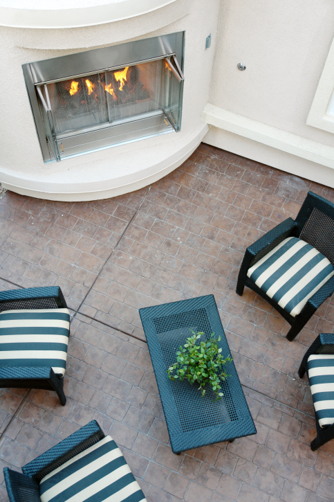 Flagstone patio with fireplace serving as the focal point