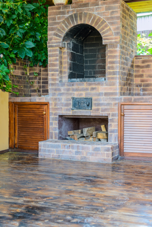 Elevated patio fireplace with wood storage below