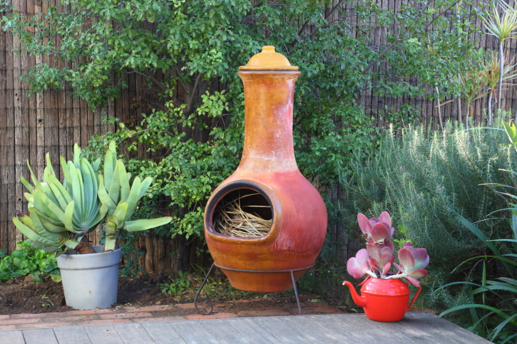 Free Standing Fireplace In Corner Of Brick Patio