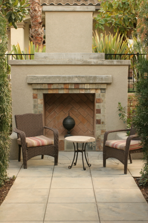 Concrete and brick fireplace on flagstone patio