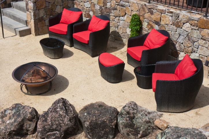 Fire pit on patio with large cushioned patio chairs