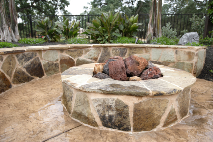 Large elevated fire pit in the middle of patio