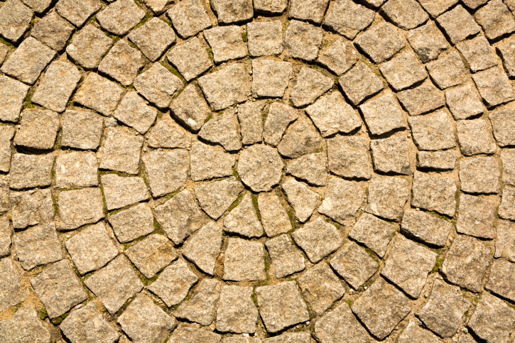 Circular cobblestone patio design