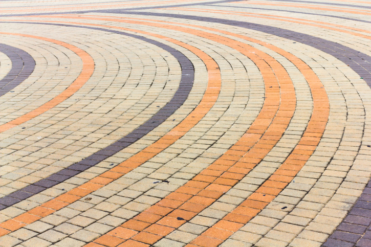 Circular or radial multi-color brick patio design