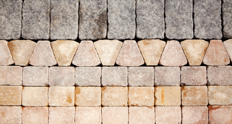 Standard brick pattern with triangular brick pattern edge topped with header