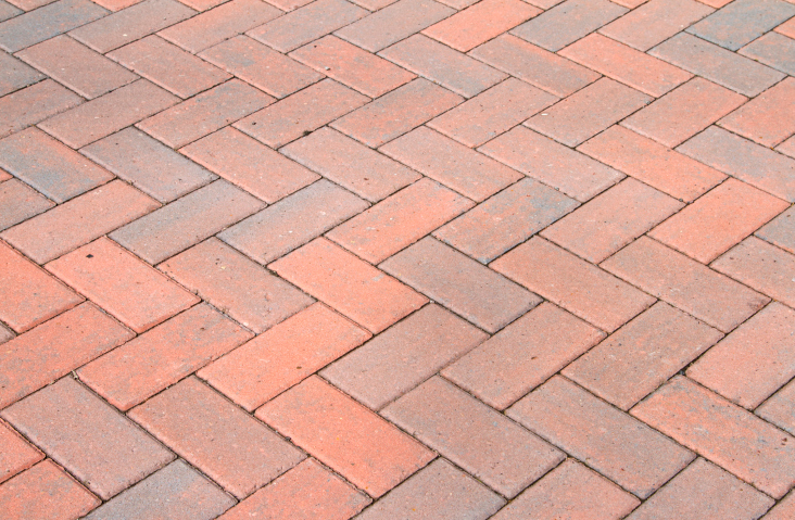 Classic herringbone brick patio pattern