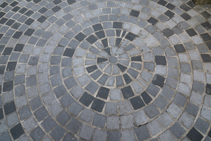 Radial grey brick patio design