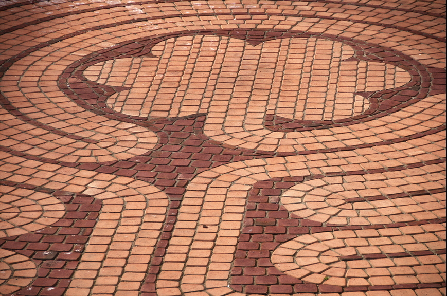 Mosaic brick pattern patio design