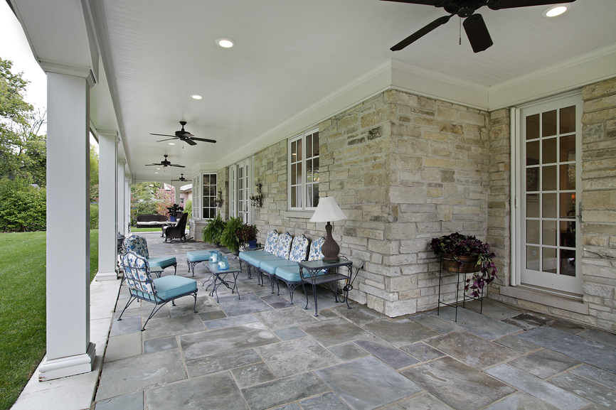 covered porch style patio extending the full length of a home - Patio Wall Design