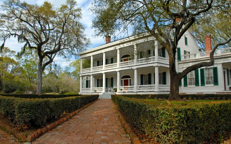 Old antebellum mansion with full-width veranda on both the first and second floors
