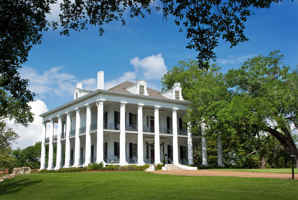 Dunleith Plantation in Natchez, Mississippi. Classic Greek revival southern mansion with pillars wrapping entirely around the large home