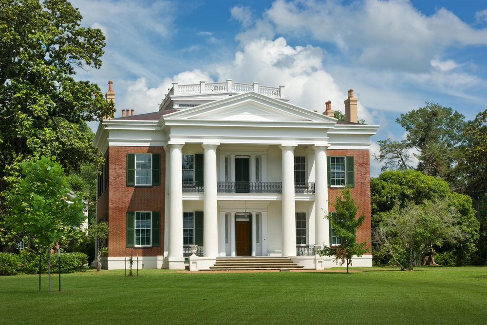 Brick Southern Mansion With 4 Large White Columns Set In A Large Estate  With Large Lawn