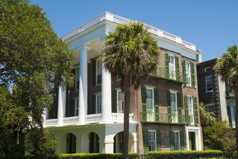 Urban southern mansion in brick with large columns spanning the full width of the front facade. Built on Bay Street, Charleston.