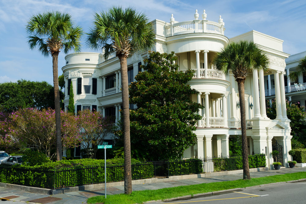 Charleston white mansion on large corner lot. This home incorporates classic southern mansion features mixed with Victorian style.