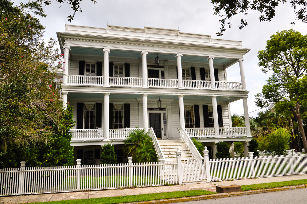 Southern town home mansion with full-width verandas on first and second floors.