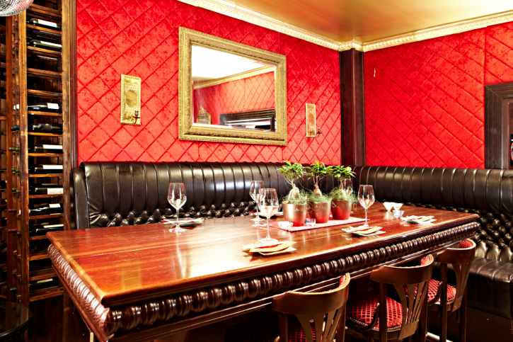 Dining room booth style with bright red walls