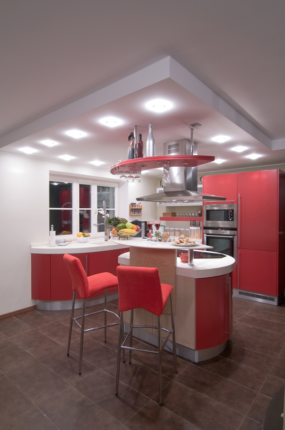 Small white and red kitchen with black floor