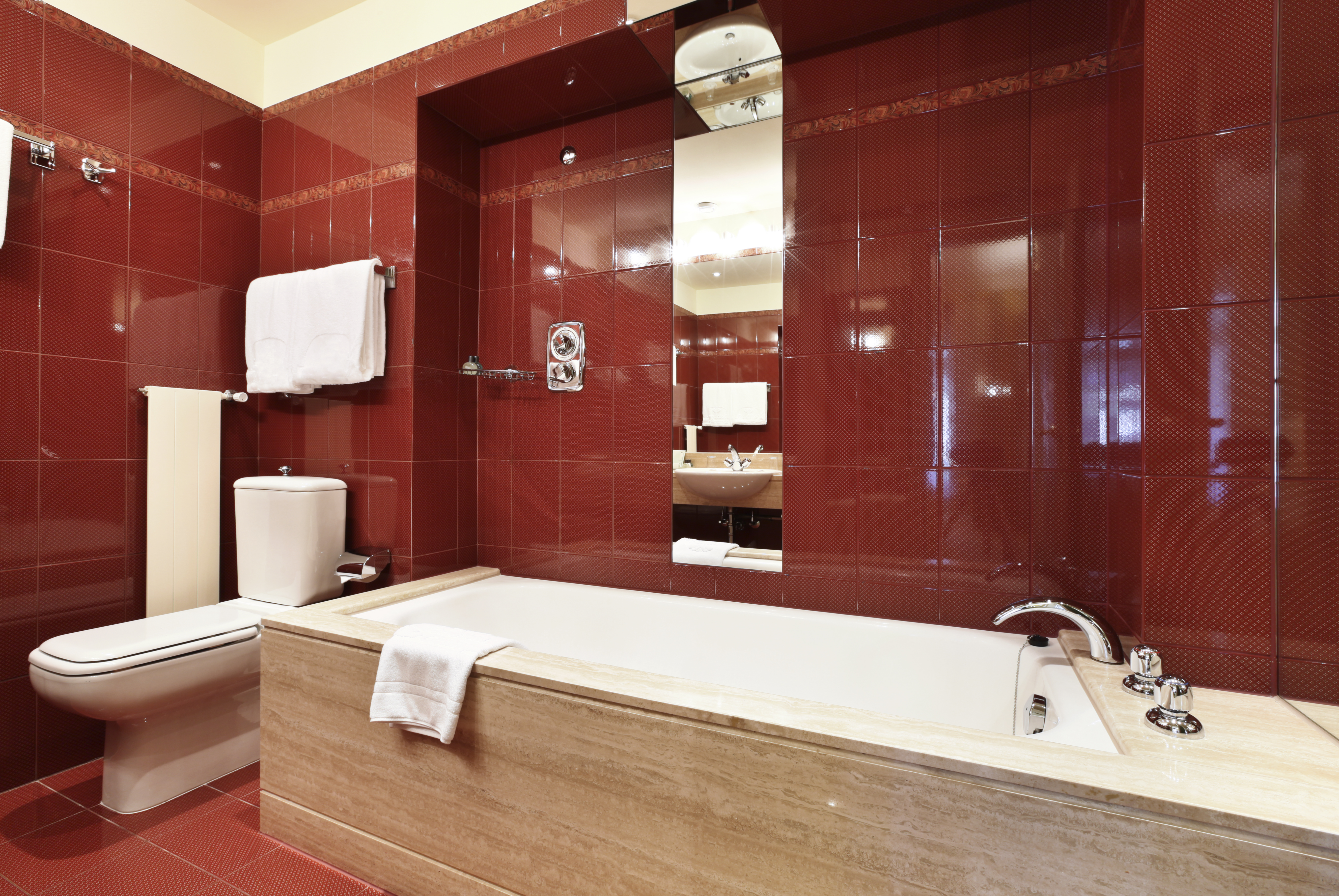 Bathroom with deep red walls and floor