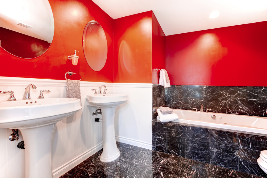 Bathroom with white, red and black marble design