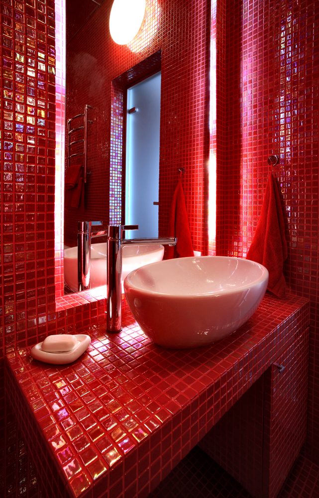 Red powder room with white vessel basin