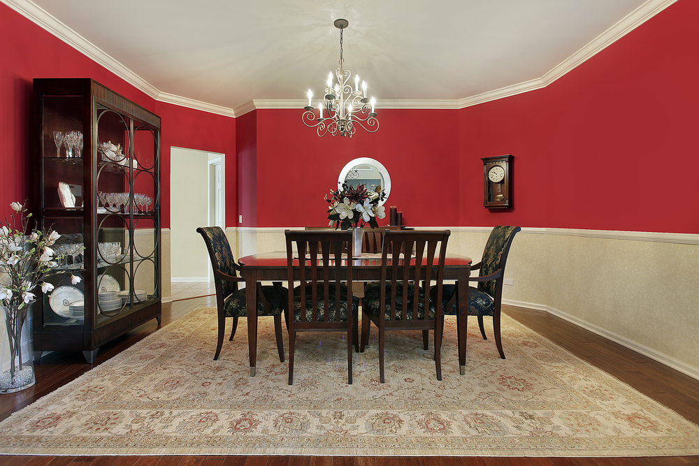 Dining Room With Red Upper Half Walls, Dark Wood Dining Set And Dark Wood  Floor