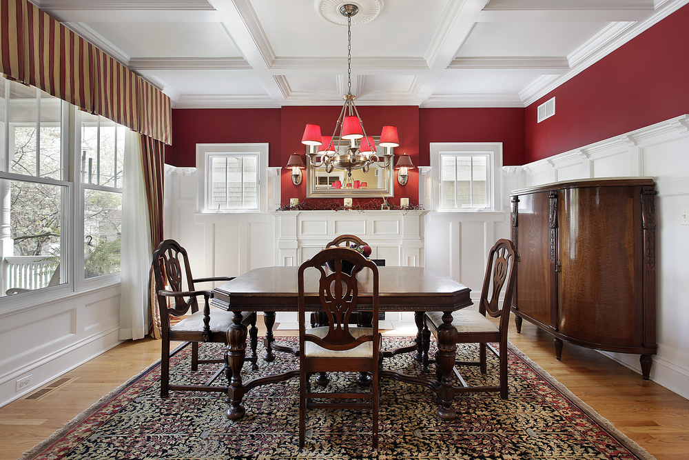 Dining room with white and red walls, white ceiling, wood floor and large rug