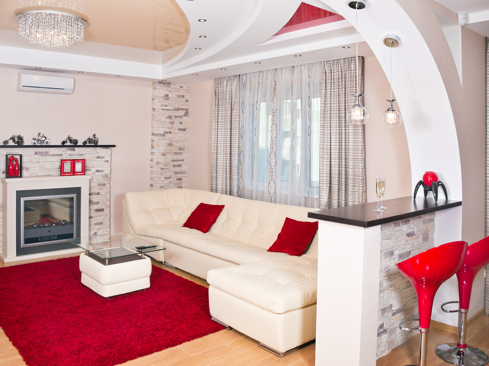 White Living Room With Sofa Red Pillows And Rug