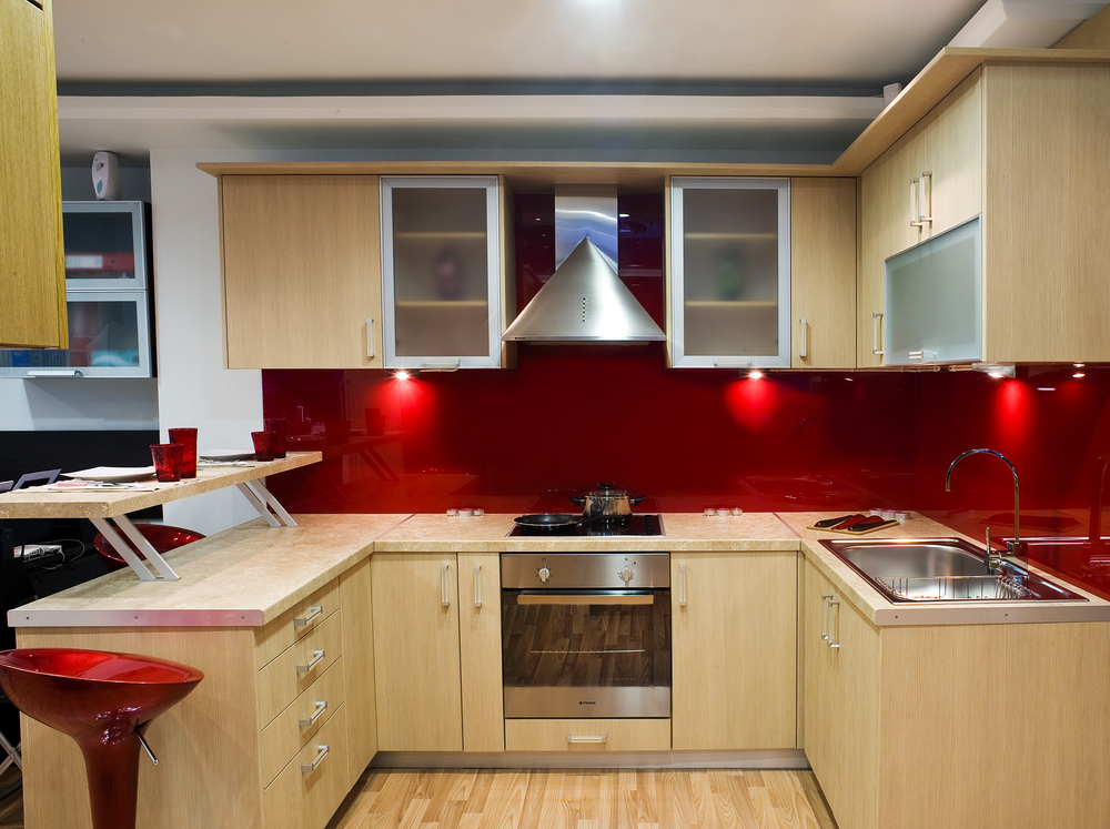 Kitchen with light wood and red design