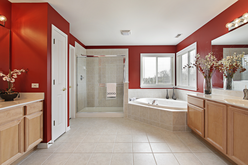 ... Large white wood and red kitchen with wood cabinets, white fixtures and  red walls