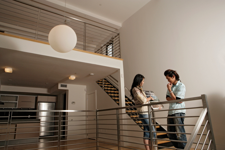 Sophisticated looking stairs and railing system, with brushed metal finish.