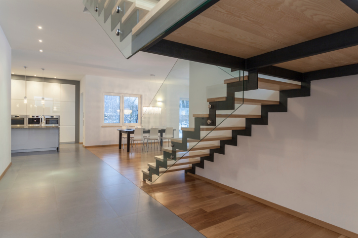 Open riser with glass balustrade and black stringer staircase