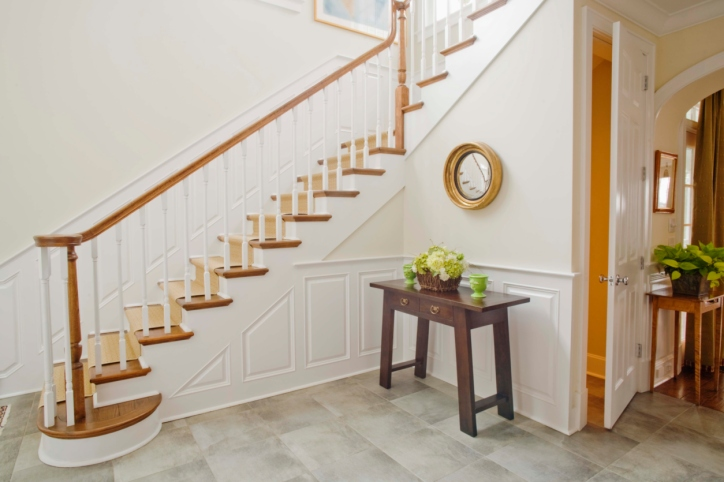 Traditional white and wood staircase that is elegant.