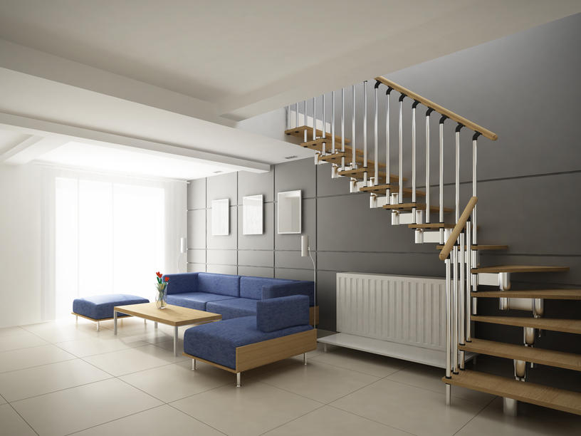 Modern staircase with metal balustrade and wooden hand rail and treads.