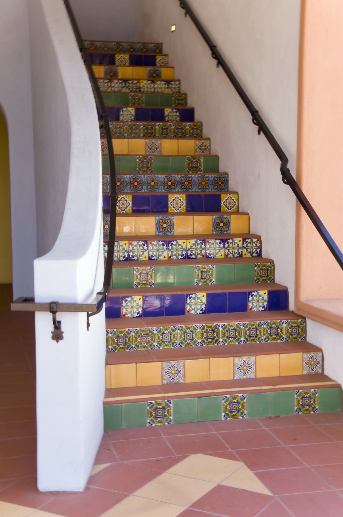 Tiled staircase in bright colours.
