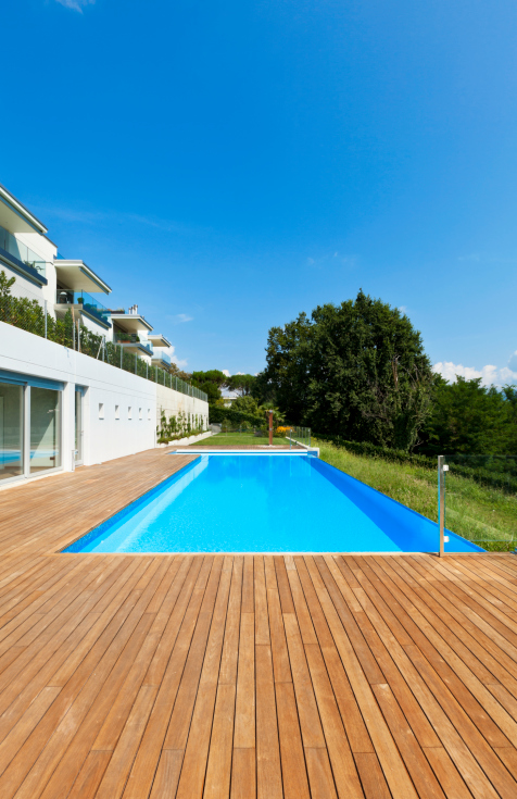 Simple backyard rectangle pool with L-shaped wooden deck