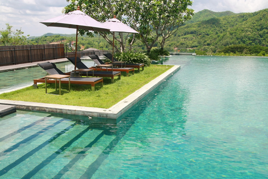 huge pool with grass patio island - Pool Design Ideas