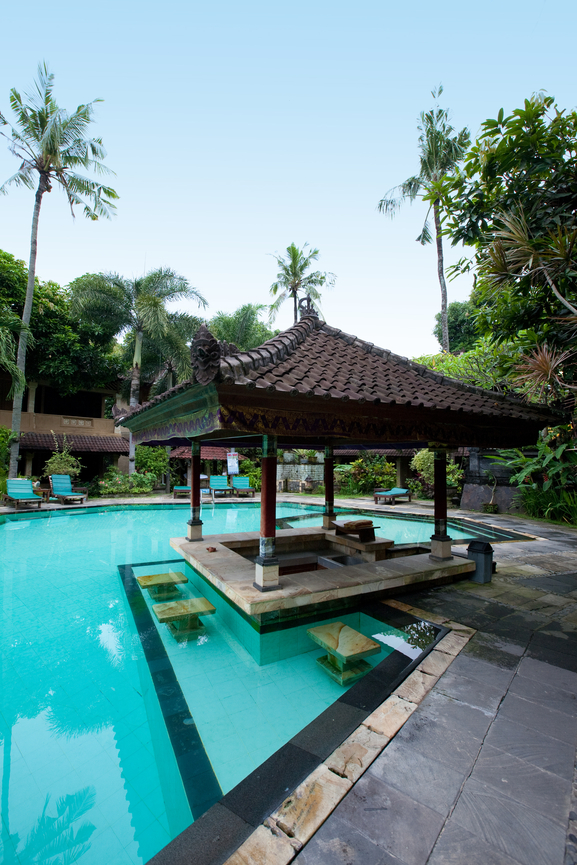 Tropical pool with gazebo on the edge