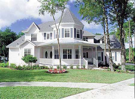Contemporary all white Victorian home with small front porch