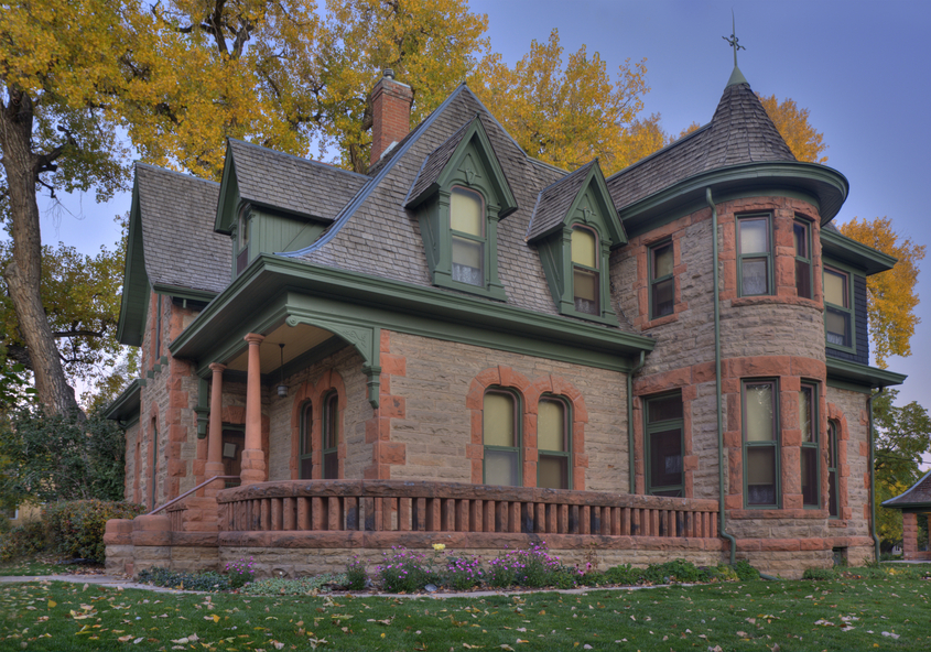 brick victorian home with front deck in fort collins colorado - Victorian House Design