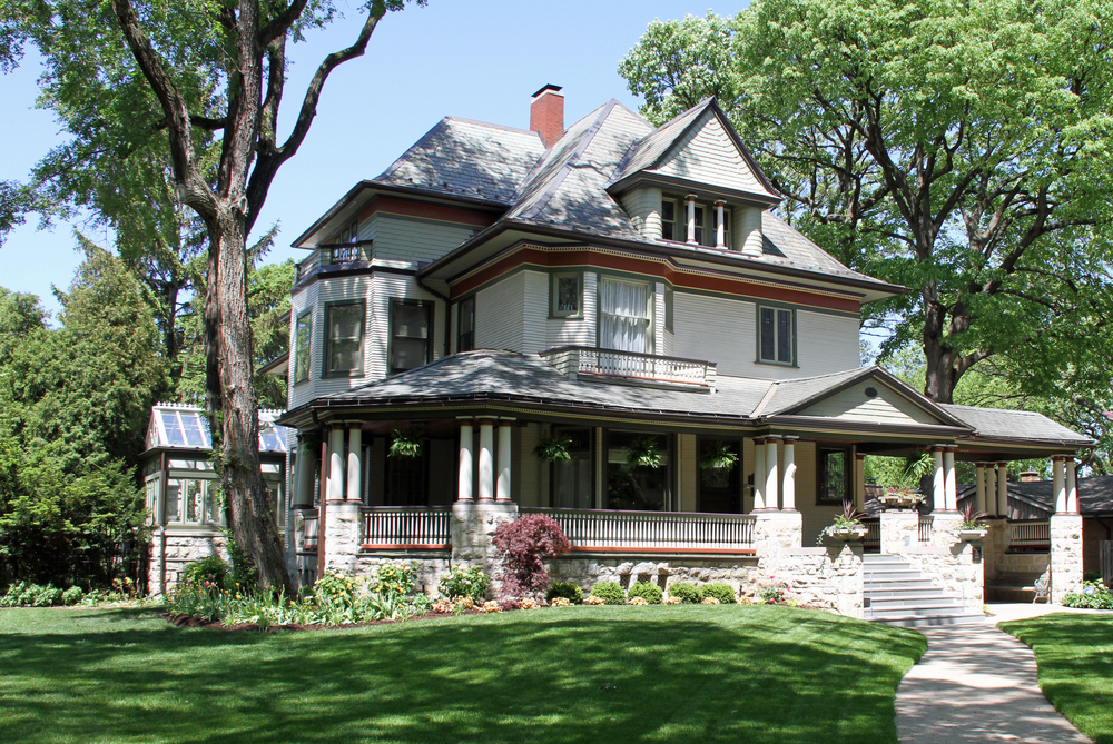 modestly designed three story victorian home with full width front porch and solarium in the - Victorian House Design