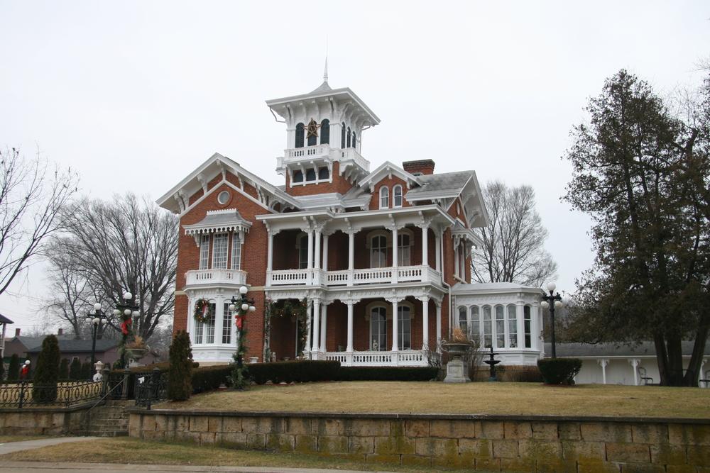 Gingerbread Victorian Mansion Built With Red Brick Including Extensive Use White Trim And Supporting Columns