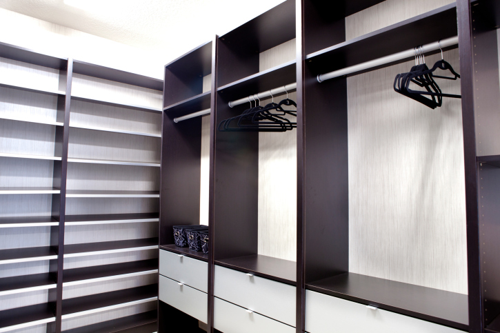 Dark wood and white walk-in closet design
