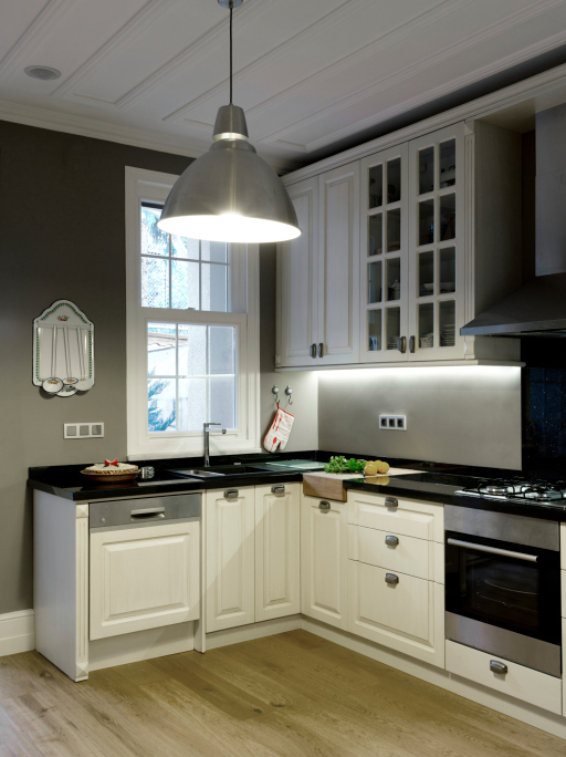 White Kitchen with Dark Counter Top and Walls
