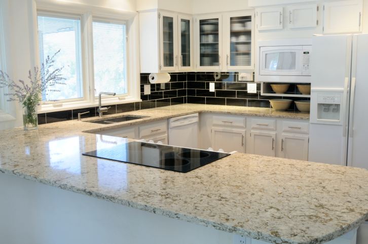 White Kitchen with Peninsula and Brownish Granite Counter Tops