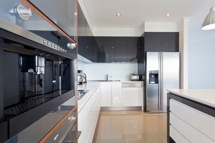 White and Stainless Steel Kitchen with Wood Flooring