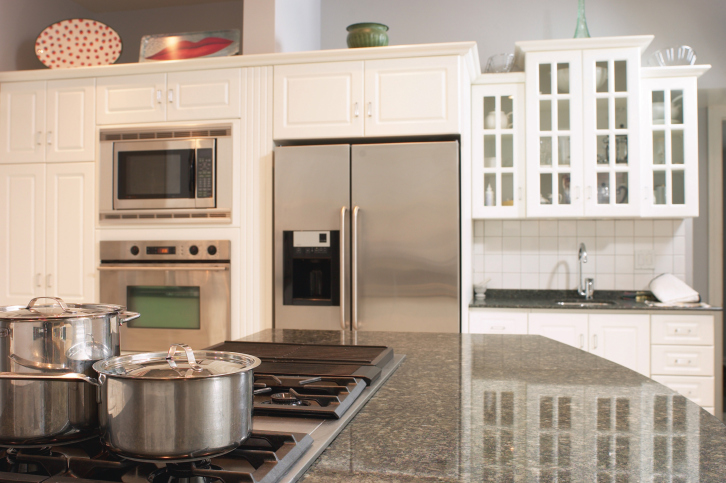 White Kitchen with Large Granite Top Island (with Stove)
