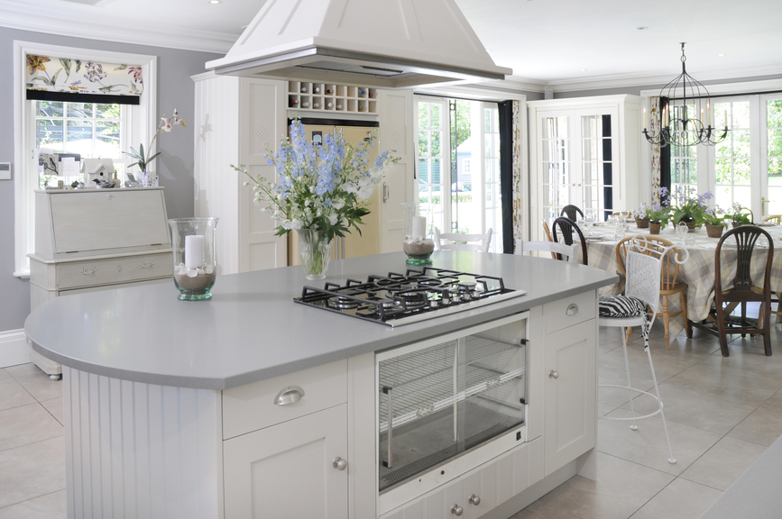 stylish white kitchen with large island - White Kitchens