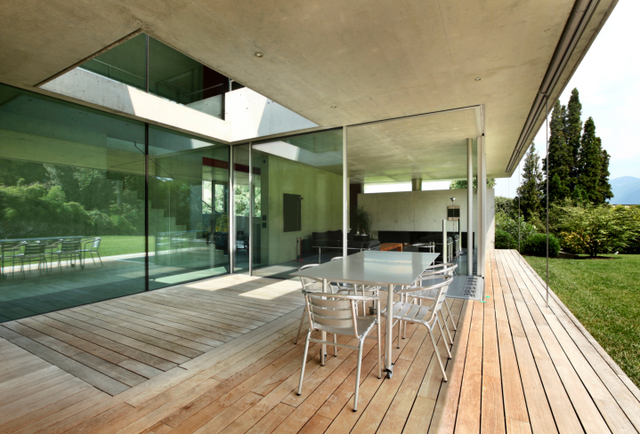 Long light wood covered deck with no railing